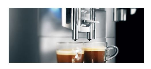 jura s9 and 2 coffee cups