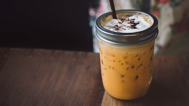 cold brew coffee with milk and ice in a jar
