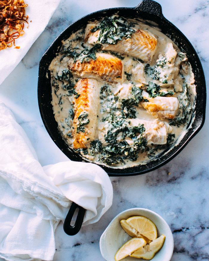 cooked fish and souce in skillet