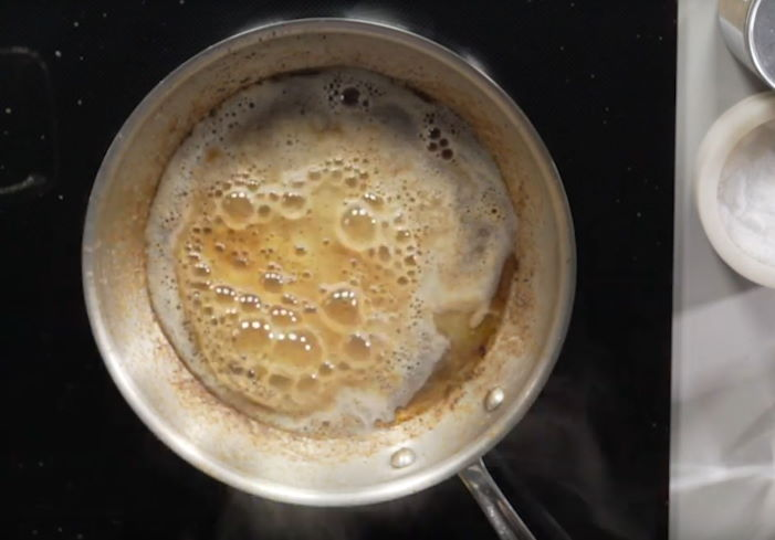 boiling baking soda and water mixture in stainless steel pan
