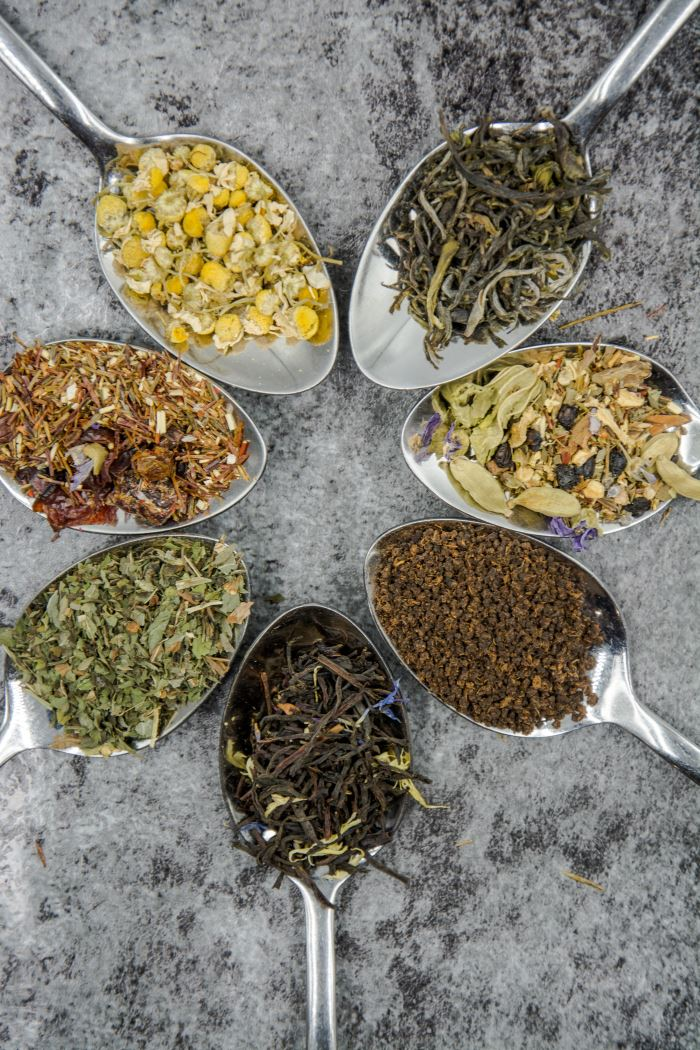 7 spoons with different types of tea