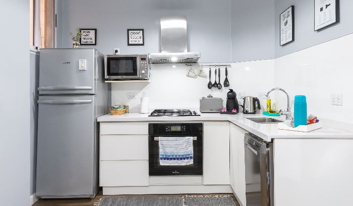 Toaster Oven on shelf In Small Kitchen