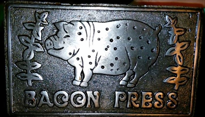 large square cast iron bacon press