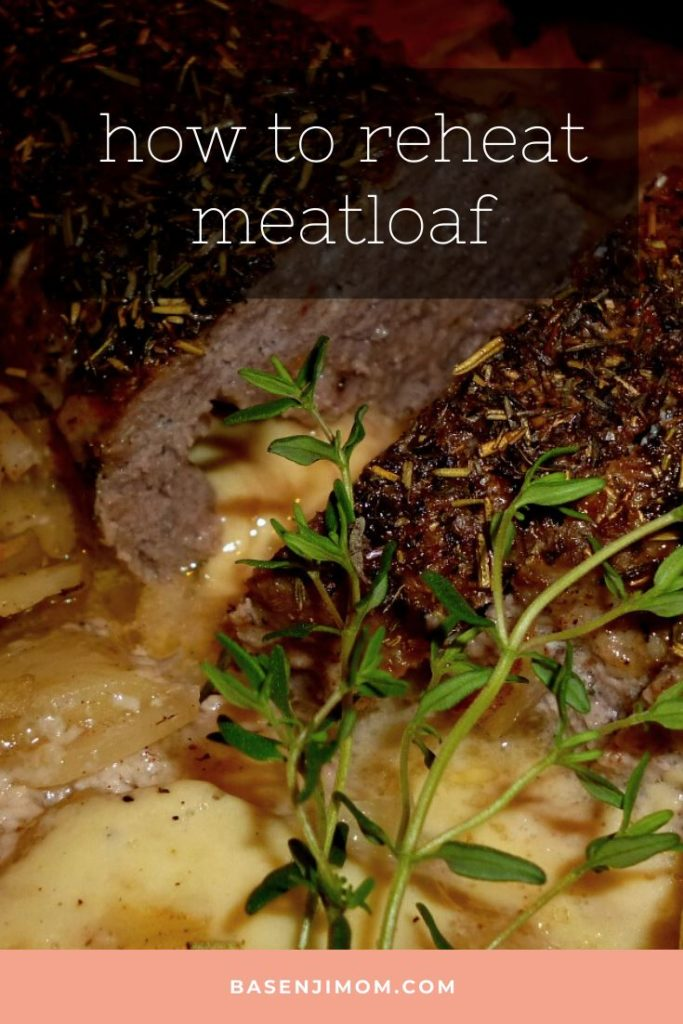 cut loaves of meatloaf with rosemary and baked potatoes