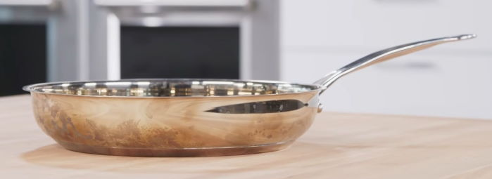 cheap steel pan with visible aluminum disk