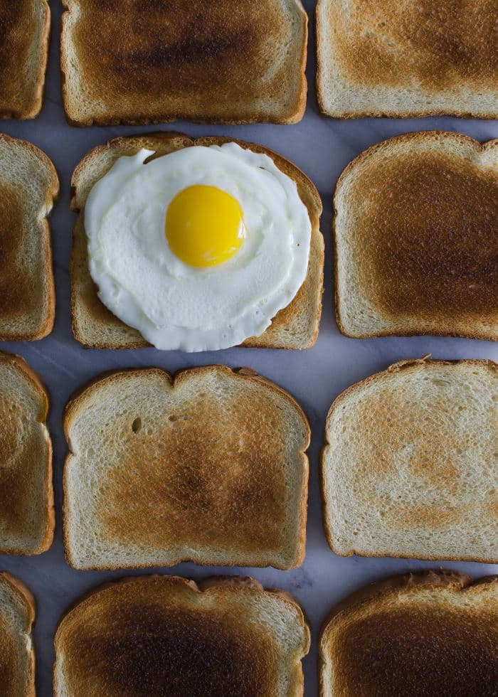 many slices of toasted bred and baked egg